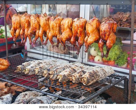 Row Of Grilled Fish And Hens On The Street Market