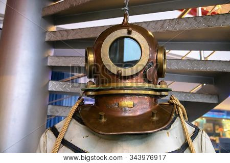 Close-up Helmet Old Vintage Three-bolt Deep-sea Diving Suit. Suit For Deep Sea Diving Of The Last Ce