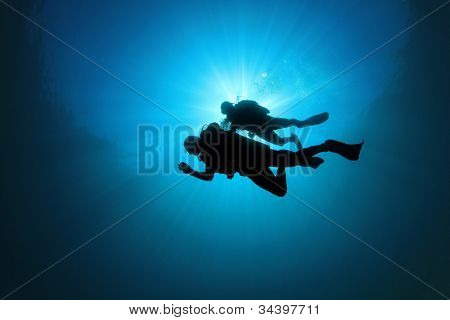 Couple of Scuba Divers Underwater