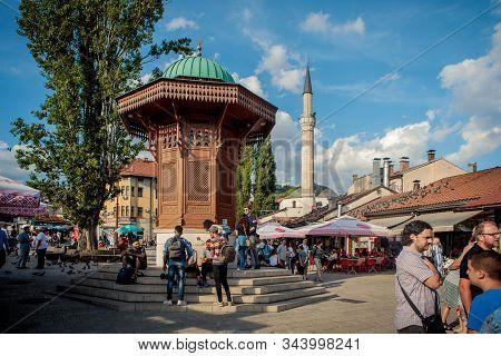Sarajevo, Bosnia And Herzegovina - July 11, 2019: Bascarsija Square With Sebilj Wooden Fountain In O