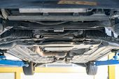 chassis bottom view and power steering rack and suspension system of saloon or sedan car at garage lift up for maintenance poster
