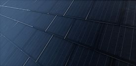 Black Solar Roof Tiles. Building-integrated Photovoltaics System Consisting Of Modern Monocrystal Bl