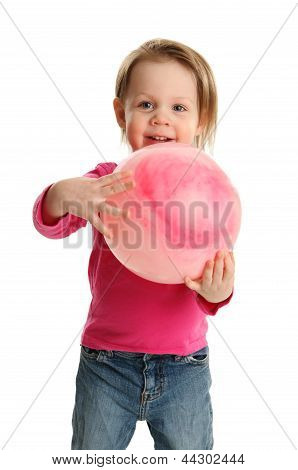 Preschool Child Playing With A Ball