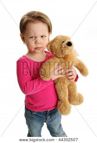Child Holding A Teddy Bear With Mad Expression