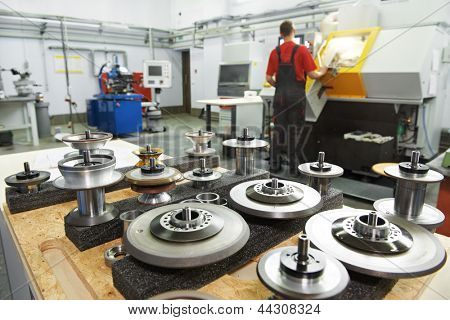 industrial cutting tools in front of cnc milling machine center in tool workshop manufacturing