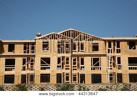 New Home or Condo Community Construction Site. New Homes being built with wood and other construction materials for new home buyers to live in and raise their families in Southern California.