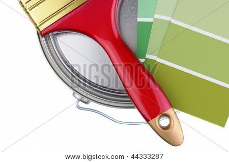Overhead closeup of painting supplies over a white background. Paintbrush, and paint chips resting on top of a closed paint can. Horizontal format.
