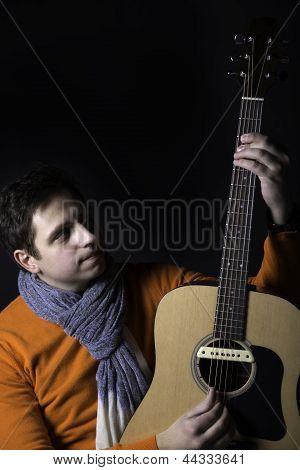 Man On Background Play Guitar Unusual Way.