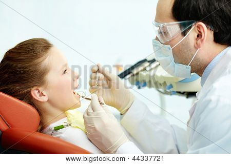 Side view of a dentist and his patient