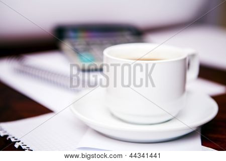 Coffee and the calculator on monitor