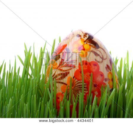 Easter Egg In The Grass Isolated On White