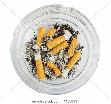 Stubs In Glass Ashtray Top View