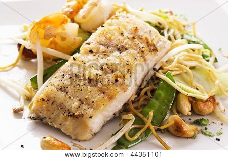 fish with noodles and vegetable poster