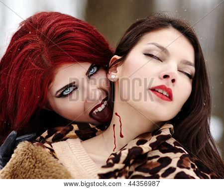Redheaded Vampire Biting Innocent Girl