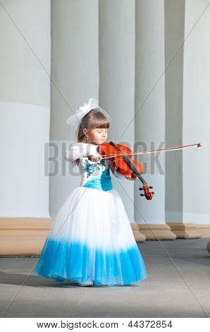 Violinist. Pretty Girl In A Smart Dress With A Violin