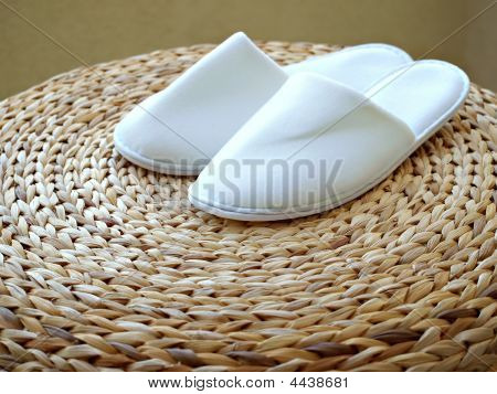 White Bedroom Slippers On Weaved Stool