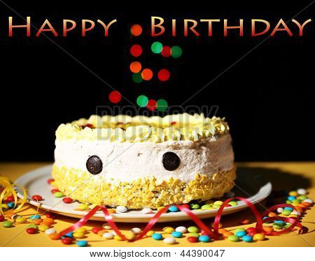 Happy birthday cake, on black background