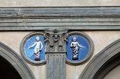 Piazza della Santissima Annunziata in Florence. Ospedale degli Innocenti. Ceramic tondo by Andrea della Robbia poster
