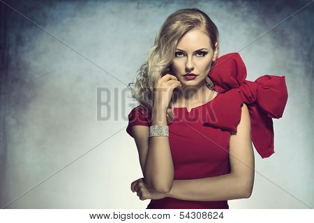 Elegant Girl Looking In Camera In Red