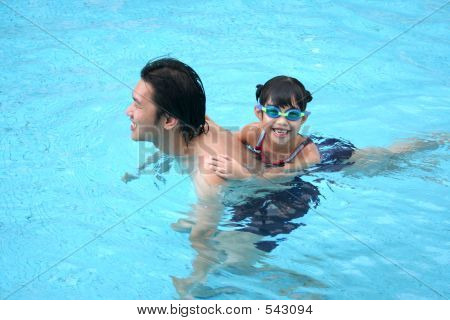 Man & Girl In The Pool