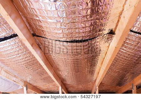 Reflective Radiant Heat Barriers Between Attic Joists Used As Baffle