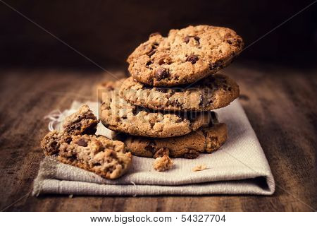 Chocolate Cookies On White Linen Napkin On Wooden Table. Chocolate Chip Cookies Shot On Coffee Color
