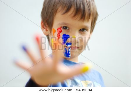 Kid With Color On His Fingers And Face