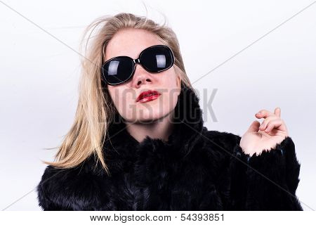 Upper Class Girl In Dark Sunglasses, Red Lipstick And Fur