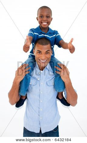 Father Giving Son Piggyback Ride With Thumbs Up