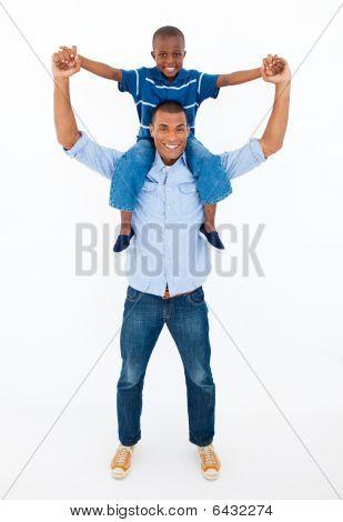 Dad Giving Son Piggyback Ride