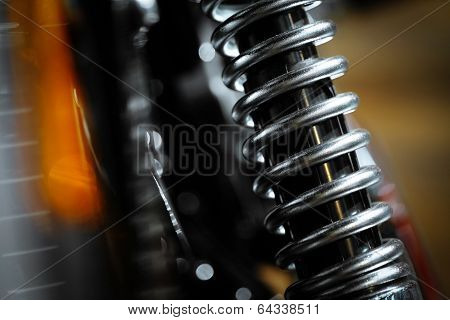 Color shot of a motorcycle shock absorber. poster