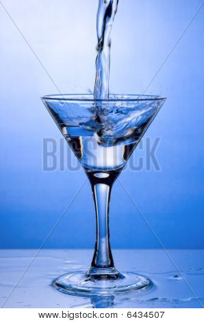 Pouring Drink In Martini Glass