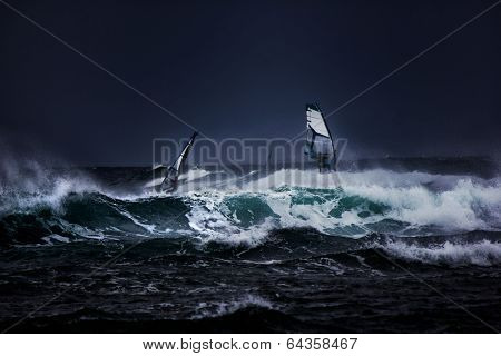 Windsurfers in a storm