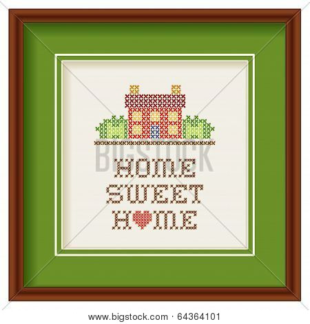 Embroidery, Home Sweet Home with a big heart in rustic colors, needlework house in landscape graphic cross stitch sewing design isolated on white background, green mat, mahogany picture frame. poster