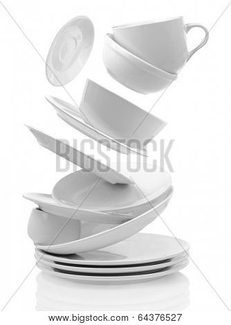 Clean empty plates and cups isolated on white