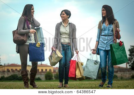 Three Happy Girls Doing Shopping