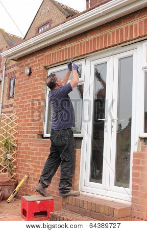 A Window fitter removing old windows