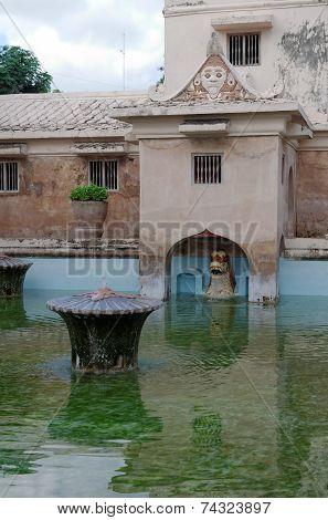 ancient pool at taman sari water castle - the royal garden of sultanate of jogjakarta