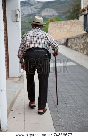 Old Man Walking On Aisle With Cane