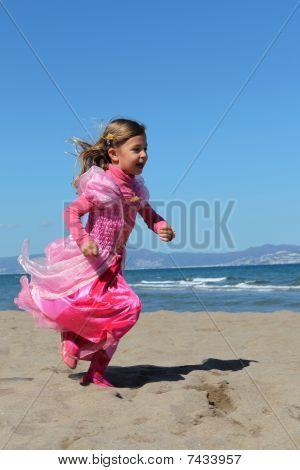 Princess running along the beach
