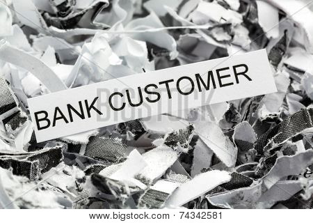 shredded paper tagged with bank customer, symbol photo for data destruction, customer data and bank secrecy