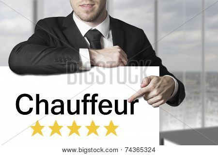 Businessman Pointing On Sign Chauffeur
