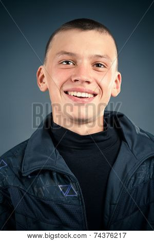 Close-up Of The Young Man In The Black Clothes, Smiling