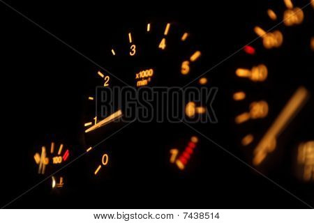 vehicle dashboard. devices. focus on pointer of tachometer