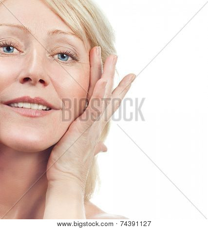 closeup portrait of attractive  caucasian smiling old mature riffles woman brunette isolated on white studio shot lips toothy smile face hair head and shoulders looking at camera tooth
