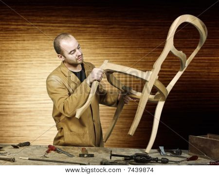 poster of fine portrait of craftsman at work isolated and wood background