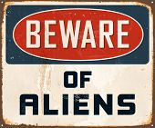 Vintage Metal Sign - Beware of Aliens - Vector EPS10. Grunge effects can be easily removed for a brand new, clean design. poster