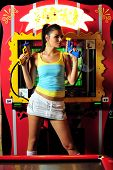 attractive sexy woman in the club with video games poster