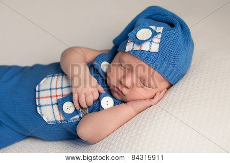 Sleeping Baby Boy In An Upcycled Romper