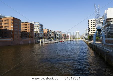 Sandtorhafen in the Hafencity in Hamburg Germany with a mixture of old and new architecture poster